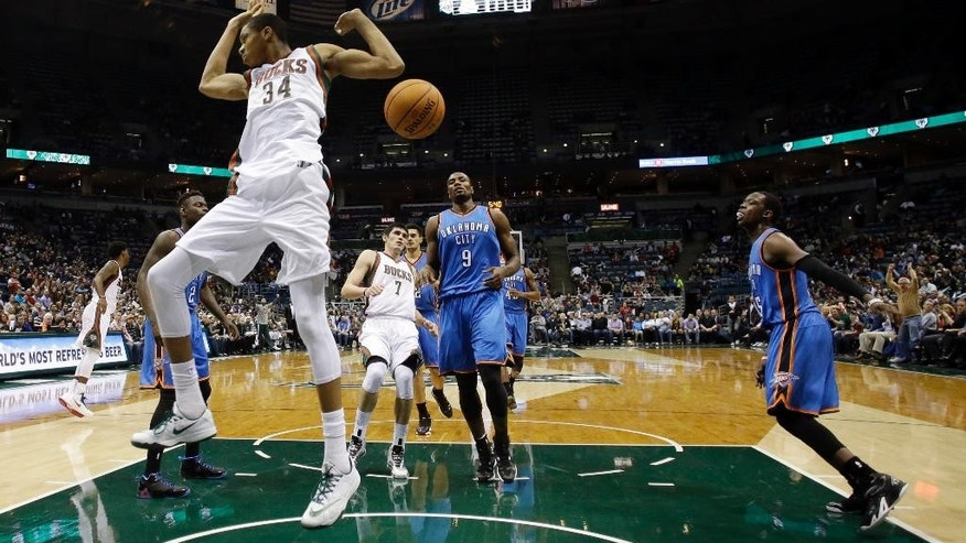 Milwaukee Bucks' Giannis Antetokounmpo dunks during the second half of an NBA basketball game against the Oklahoma City Thunder on Tuesday, Nov. 11, 2014, in Milwaukee. The Bucks won 85-78. (AP Photo/Morry Gash)