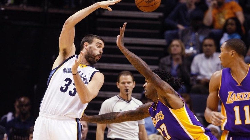 Memphis   Grizzlies Marc Gasol (33) works around Los Angeles Lakers Jordan Hill (27) in the first half of an NBA basketball game Tuesday, Nov. 11, 2014, in Memphis, Tenn. (AP Photo/Karen Pulfer Focht)