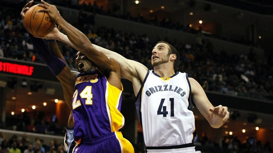Memphis Grizzlies Kosta Koufos (41)  attempts to get the ball away from Los Angeles Lakers Kobe Bryant in the first half of an NBA basketball game Tuesday, Nov. 11, 2014, in Memphis, Tenn. (AP Photo/Karen Pulfer Focht)