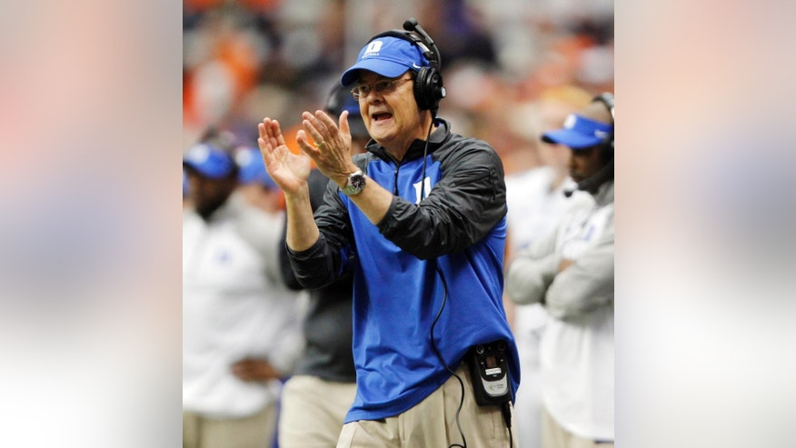 Duke's head coach David Cutcliffe calls out to his player in the second quarter of an NCAA college football game against Syracuse in Syracuse, N.Y., Saturday, Nov. 8, 2014. Duke won 27-10. (AP Photo/Nick Lisi)
