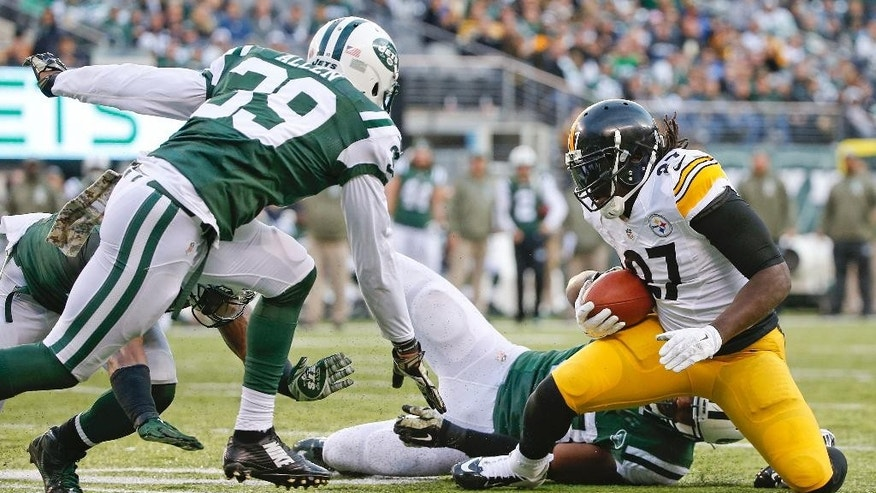 Pittsburgh Steelers running back LeGarrette Blount (27) is tackled by New York Jets' Quinton Coples as Jets' Antonio Allen (39) closes in near the goal line during the second half of an NFL football game Sunday, Nov. 9, 2014, in East Rutherford, N.J. (AP Photo/Kathy Willens)