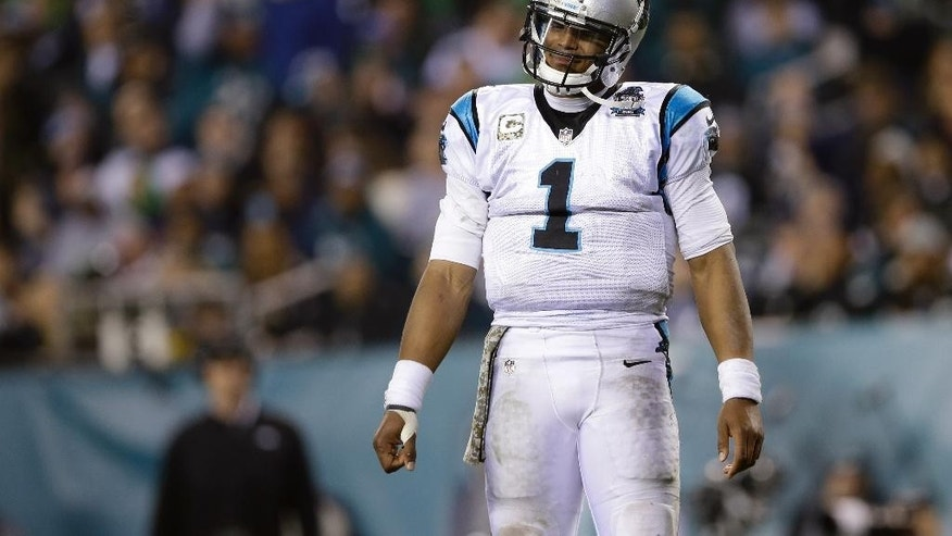 Carolina Panthers' Cam Newton reacts after being sacked during the second half of an NFL football game against the Philadelphia Eagles, Monday, Nov. 10, 2014, in Philadelphia. (AP Photo/Michael Perez)