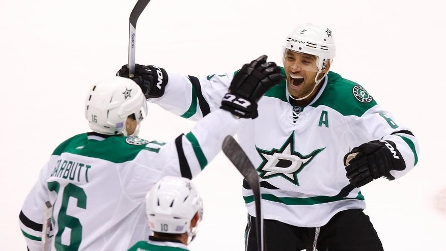 Dallas Stars' Ryan Garbutt (16) celebrates his short-handed goal against the Arizona Coyotes with teammate Trevor Daley (6) during the third period of an NHL hockey game Tuesday, Nov. 11, 2014, in Glendale, Ariz.  The Stars defeated the Coyotes 4-3. (AP Photo/Ross D. Franklin)