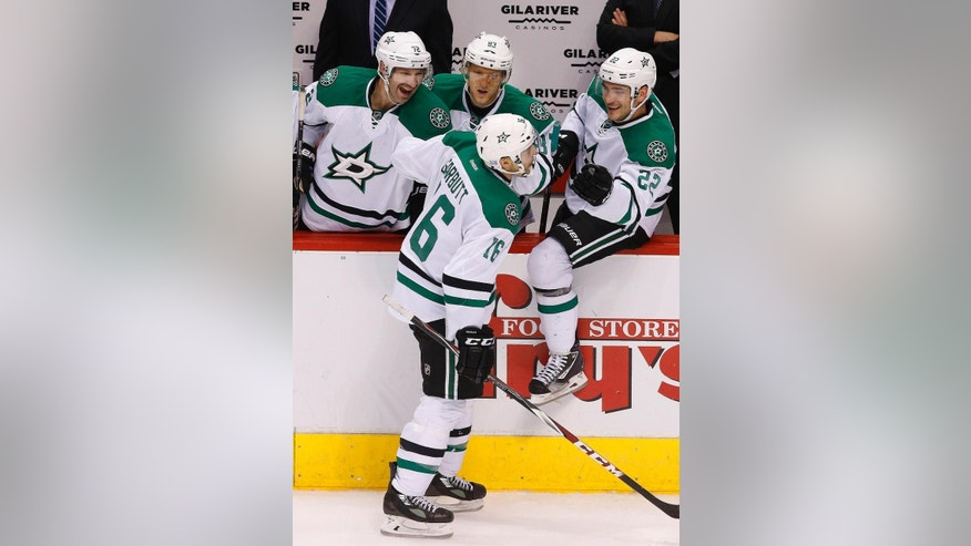 Dallas Stars' Ryan Garbutt (16) celebrates his short-handed goal against the Arizona Coyotes with teammates Erik Cole (72); Ales Hemsky (83), of the Czech Republic; and Colton Sceviour (22) during the third period of an NHL hockey game Tuesday, Nov. 11, 2014, in Glendale, Ariz. The Stars defeated the Coyotes 4-3. (AP Photo/Ross D. Franklin)