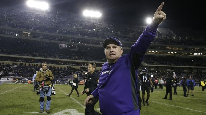 TCU head coach Gary Patterson points to fans as he runs off the field after an NCAA college football game against Kansas State Saturday, Nov. 8, 2014, in Fort Worth, Texas. TCU won 41-20. (AP Photo/LM Otero)