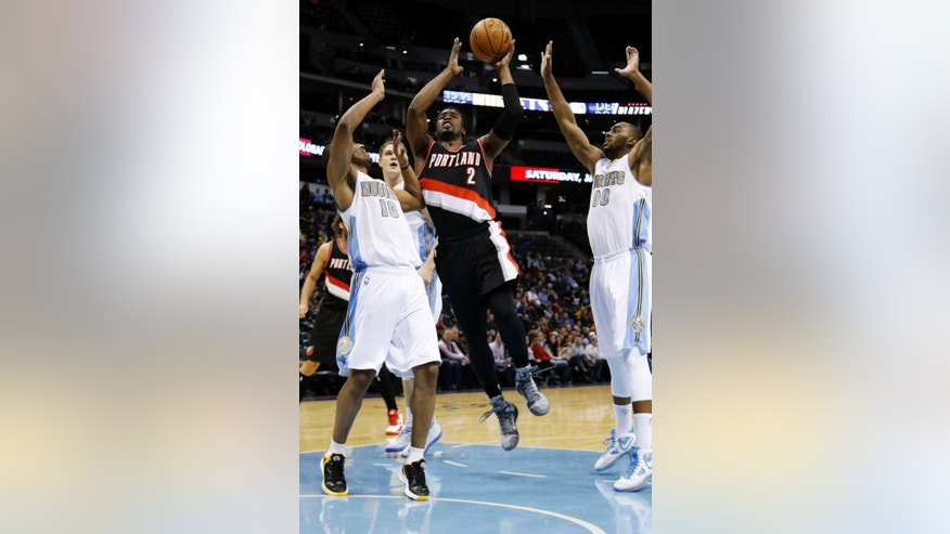 Portland Trail Blazers guard Wesley Matthews (2) goes up for a shot between Denver Nuggets guard Arron Afflalo (10) and Darrell Arthur (00) during the first half of an NBA basketball game Wednesday, Nov. 12, 2014, in Denver. (AP Photo/Jack Dempsey)