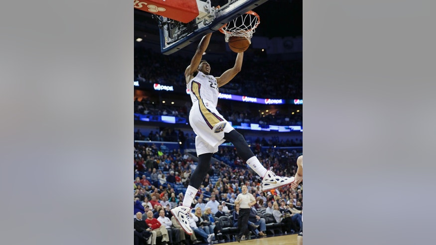 New Orleans Pelicans forward Anthony Davis dunks during the second half of an NBA basketball game against the Los Angeles Lakers in New Orleans, Wednesday, Nov. 12, 2014. The Pelicans won 109-102. (AP Photo/Gerald Herbert)