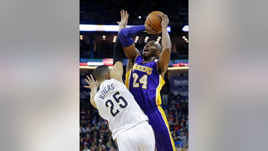 Los Angeles Lakers guard Kobe Bryant (24) shoots over New Orleans Pelicans guard Austin Rivers (25) during the first half of an NBA basketball game in New Orleans, Wednesday, Nov. 12, 2014. (AP Photo/Gerald Herbert)