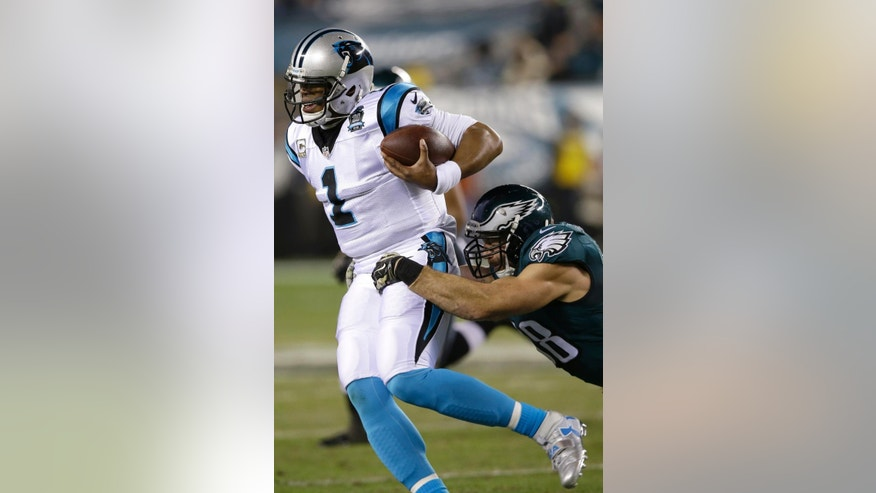 Carolina Panthers' Cam Newton, left, is tackled by Philadelphia Eagles' Connor Barwin during the first half of an NFL football game, Monday, Nov. 10, 2014, in Philadelphia. (AP Photo/Michael Perez)