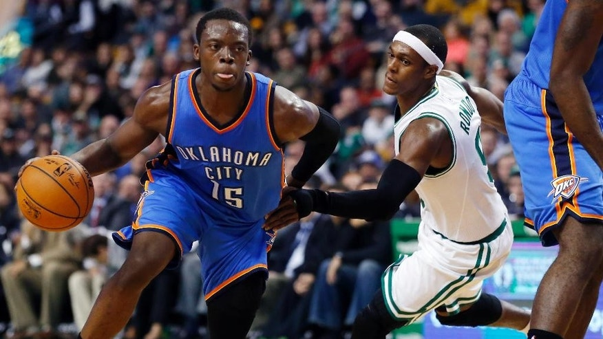 Oklahoma City Thunder guard Reggie Jackson (15) drives against Boston Celtics guard Rajon Rondo during the first half of an NBA basketball game in Boston, Wednesday, Nov. 12, 2014. (AP Photo/Elise Amendola)