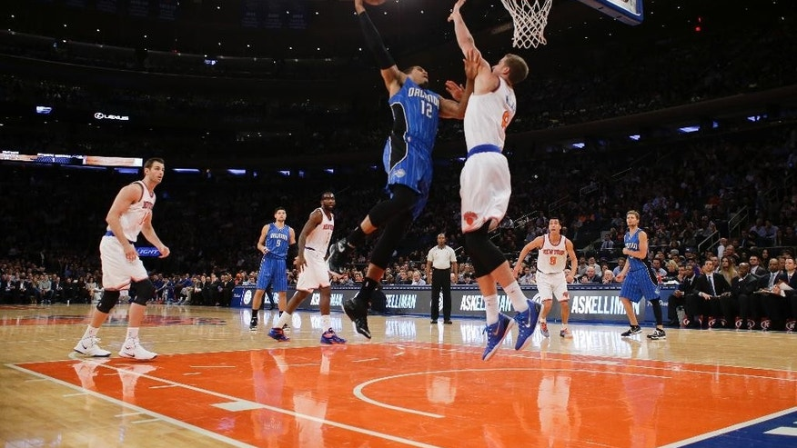 Orlando Magic's Tobias Harris (12) shoots over New York Knicks' Travis Wear (6) during the first half of an NBA basketball game Wednesday, Nov. 12, 2014, in New York. (AP Photo/Frank Franklin II)