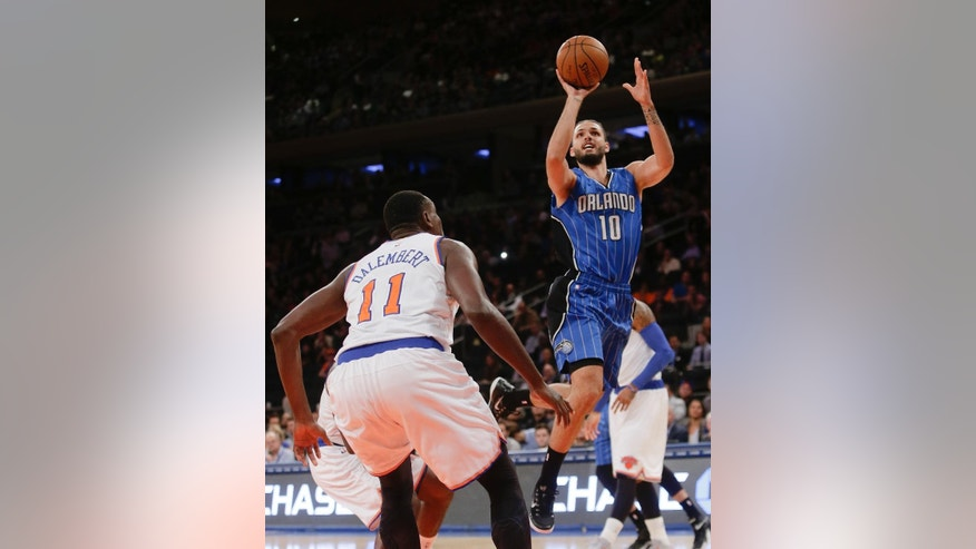Orlando Magic's Evan Fournier (10) shoots over New York Knicks' Samuel Dalembert (11) during the first half of an NBA basketball game Wednesday, Nov. 12, 2014, in New York. (AP Photo/Frank Franklin II)