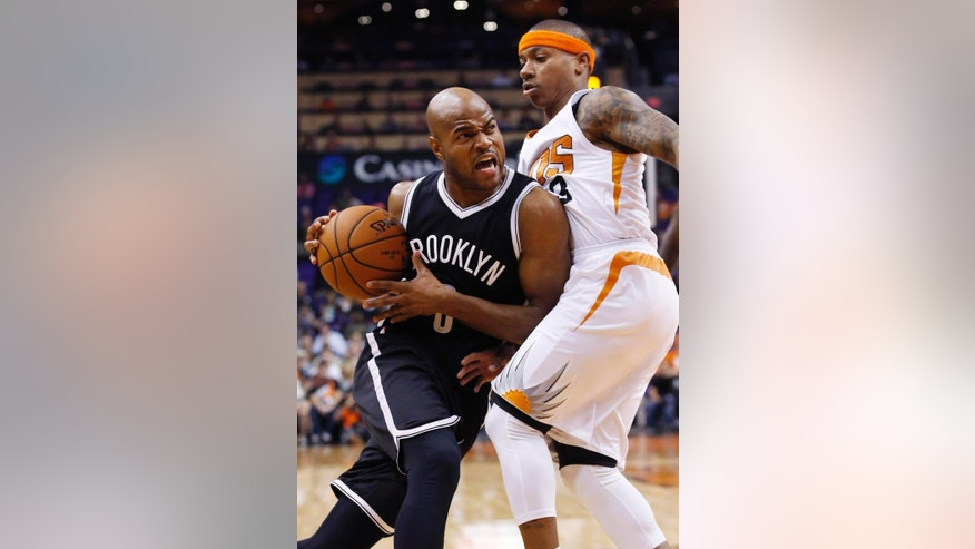 Brooklyn Nets' Jarrett Jack, left, collides with Phoenix Suns' Isaiah Thomas during the first half of an NBA basketball game Wednesday, Nov. 12, 2014, in Phoenix. (AP Photo/Ross D. Franklin)