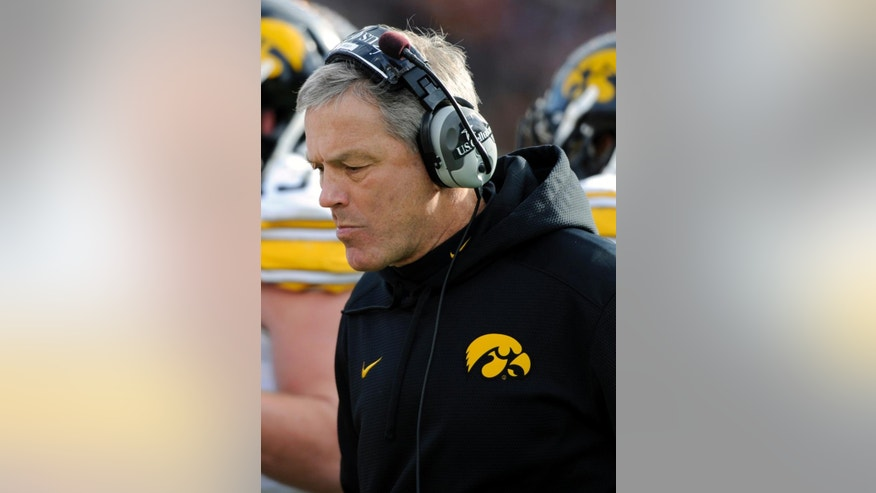 Iowa head coach Kirk Ferentz watches his team during the third quarter of an NCAA college football game against Minnesota on Saturday, Nov. 8, 2014, in Minneapolis. Minnesota won 51-14. (AP Photo/Hannah Foslien)
