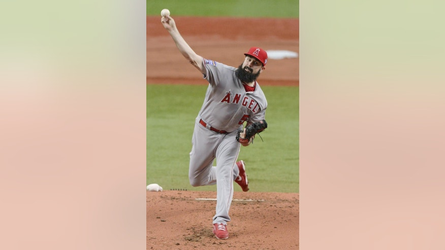 Major League All-Stars' Matt Shoemaker of Los Angeles Angels delivers a pitch against Japan at Game 1 of their exhibition baseball games in Osaka, western Japan, Wednesday, Nov. 12, 2014.  Japan won the game 2-0.   (AP Photo/Kyodo News) JAPAN OUT, MANDATORY CREDIT