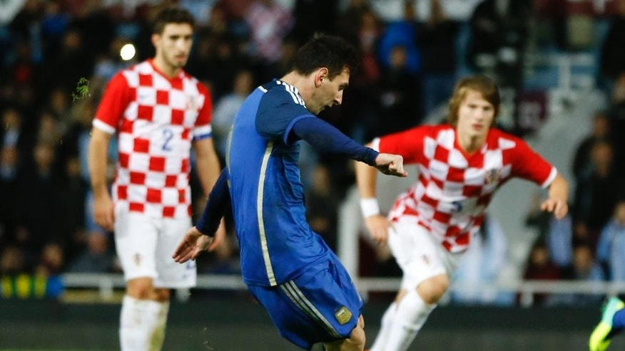 Argentina's Lionel Messi scores a goal during the international friendly soccer match between Argentina and Croatia at the Boleyn Ground in London, Wednesday, Nov. 12, 2014. (AP Photo/Kirsty Wigglesworth)
