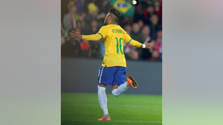 Brazil's Neymar JR celebrates during their friendly soccer match with Turkey at Sukru Saracoglu Stadium in Istanbul, Turkey, Wednesday, Nov. 12, 2014. (AP Photo)