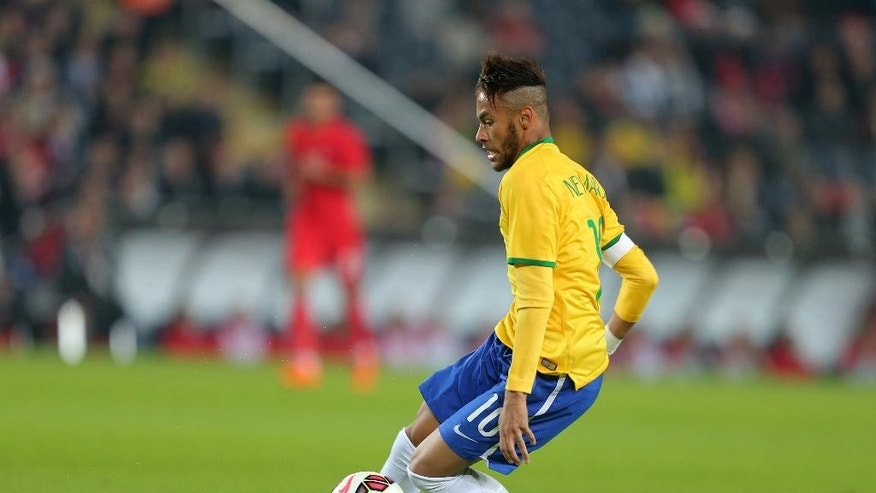 Brazil's Neymar JR in action during their friendly soccer match with Turkey at Sukru Saracoglu Stadium in Istanbul, Turkey, Wednesday, Nov. 12, 2014. (AP Photo)