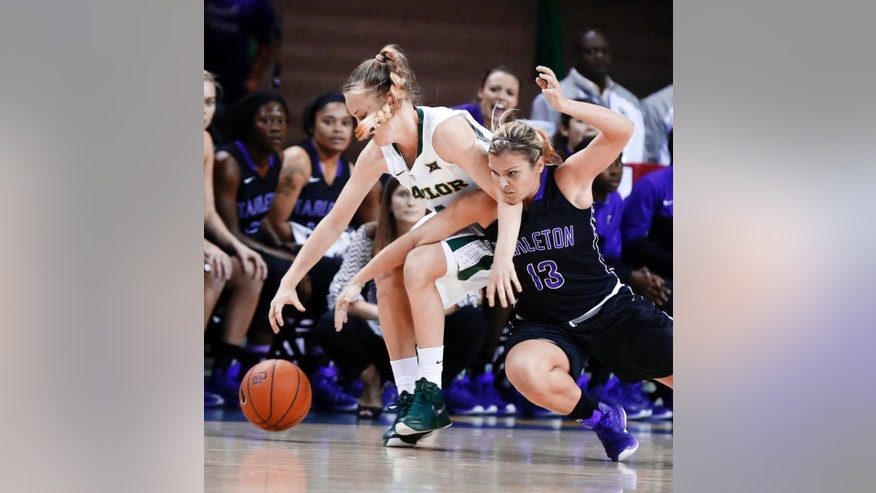 Baylor's Kristy Wallace (4) battles Tarleton State'S Raven McGrath (13) for a loose ball in the first half of an NCAA college exhibition game, Tuesday, Nov. 10, 2014, in Waco, Texas. (AP Photo/Waco Tribune Herald, Rod Aydelotte)