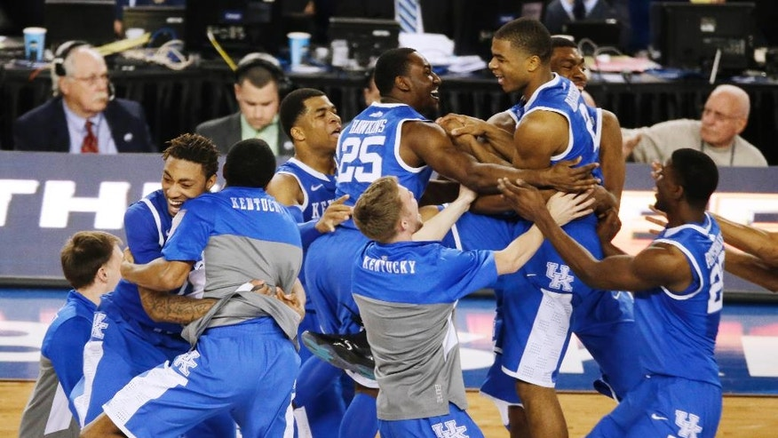 FILE - In this April 5, 2014, file photo, Kentucky celebrates after guard Aaron Harrison made a three-point basket in the final seconds against Wisconsin to win the game 74-73 during their NCAA Final Four tournament college basketball semifinal game in Arlington, Texas. This season, there are fewer star players, putting the focus on the team instead of individual players. (AP Photo/Tony Gutierrez, File)