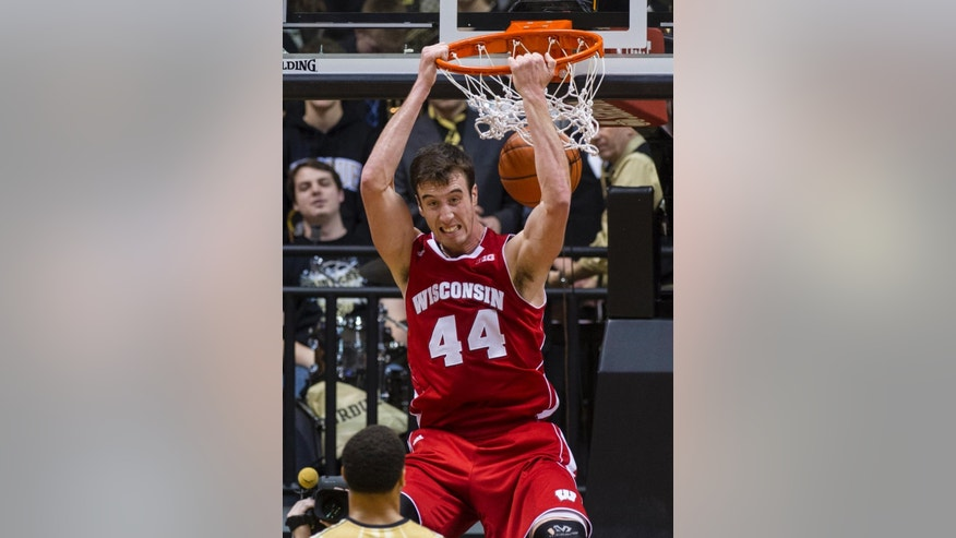 FILE - In this Jan. 25, 2014, file photo, Wisconsin's Frank Kaminsky (44) slam dunks the ball late in the second half of an NCAA college basketball game against Purdue in West Lafayette, Ind.  The 2013-14 season was known as the year of the freshmen and for good reason. This season, there are fewer star players, putting the focus on the team instead of individual players. (AP Photo/Doug McSchooler, File)