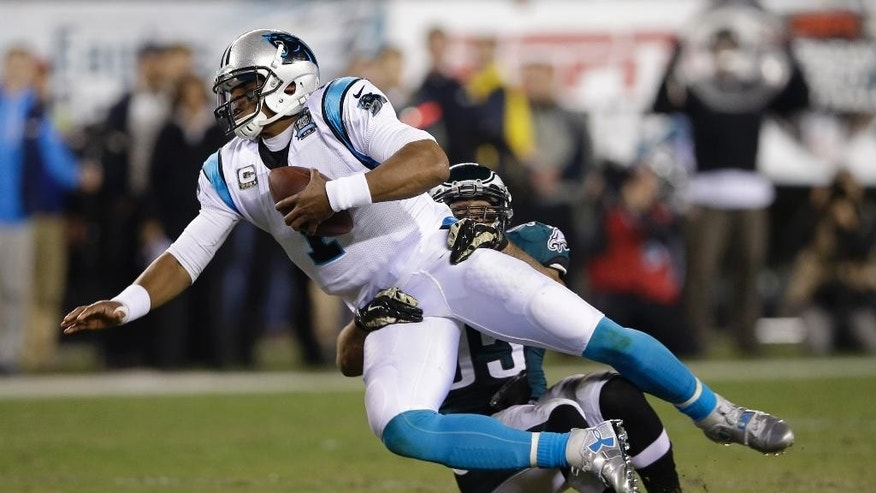 Carolina Panthers' Cam Newton (1) is tackled by Philadelphia Eagles' Mychal Kendricks (95) during the first half of an NFL football game, Monday, Nov. 10, 2014, in Philadelphia. (AP Photo/Michael Perez)