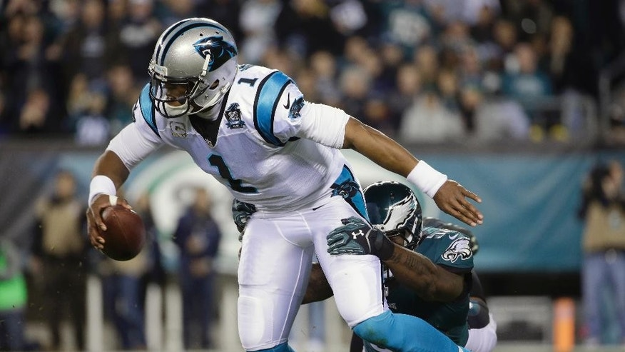 Carolina Panthers' Cam Newton, left, is tackled by Philadelphia Eagles' Trent Cole during the first half of an NFL football game, Monday, Nov. 10, 2014, in Philadelphia. (AP Photo/Matt Rourke)