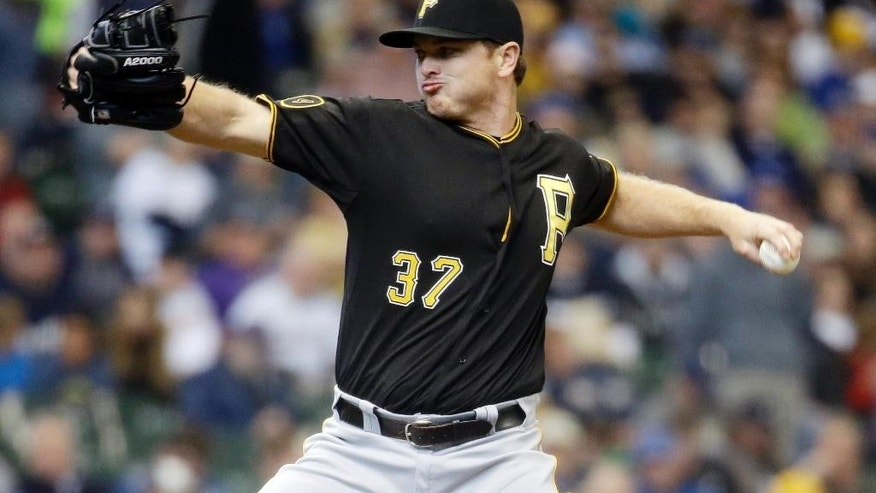 FILE - In this May 15, 2014, file photo, Pittsburgh Pirates relief pitcher Justin Wilson throws during the sixth inning of a baseball game against the Milwaukee Brewers in Milwaukee. The Pittsburgh Pirates have acquired catcher Francisco Cervelli from the New York Yankees in exchange for reliever Wilson. (AP Photo/Morry Gash, File)