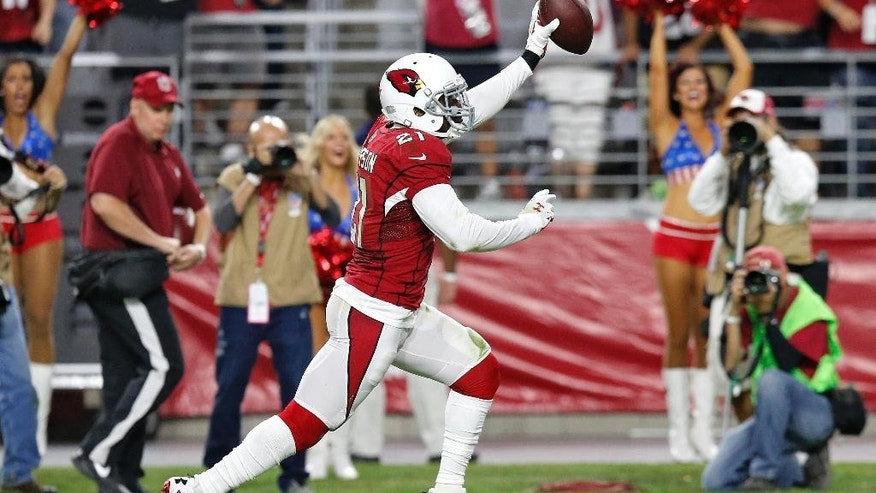 Arizona Cardinals cornerback Patrick Peterson (21) runs in an interception for a touchdown against the St. Louis Rams during the second half of an NFL football game, Sunday, Nov. 9, 2014, in Glendale, Ariz. (AP Photo/Ross D. Franklin)