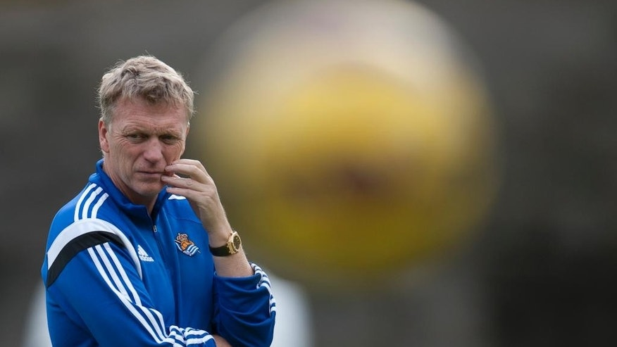 The new Real Sociedad's head manager, David Moyes of Scotland, looks on during his first training session at Zubieta place training of Real Sociedad, near to San Sebastian, northern Spain, Thursday, Nov. 13, 2014. Moyes, the former Manchester United coach is taking over from Jagoba Arrasate, who had earned only one win in 10 matches before being fired. Sociedad is Moyes' first coaching job since being fired by United last season. (AP Photo/Alvaro Barrientos)