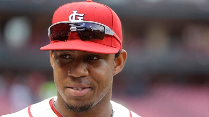 FILE  - This May 31, 2014 file photo shows St. Louis Cardinals' Oscar Taveras smiling after the Cardinals' 2-0 victory over the San Francisco Giants in St. Louis. (AP Photo/Jeff Roberson, file)
