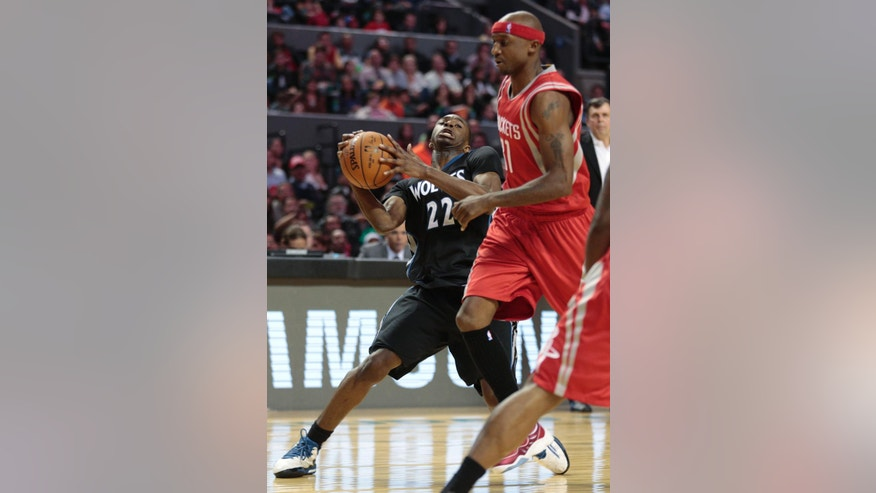 Minnesota Timberwolves' Andrew Wiggins (22) changes direction as he drives to the basket as Houston Rockets' Jason Terry defends during the second half of an NBA basketball game in Mexico City, Wednesday, Nov. 12, 2014. (AP Photo/Eduardo Verdugo)