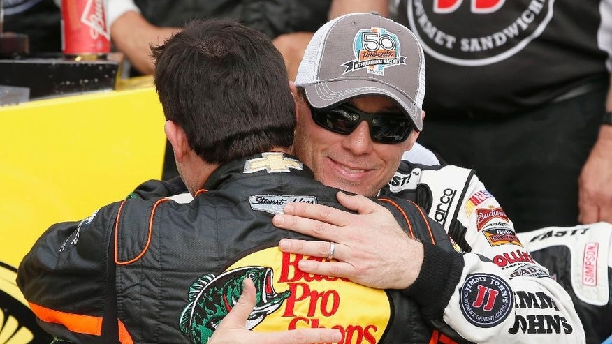 "FILE - In this March 2, 2014, file photo, Kevin Harvick, right, gets a hug from Tony Stewart after Harvick won the NASCAR Sprint Cup Series auto race in Avondale, Ariz. The bond is deep between Harvick and Stewart. Harvick said. ""He's been an owner, he's been a friend and he's been somebody I've been able to lean on over these last nine weeks."" (AP Photo/Ross D. Franklin, File)"