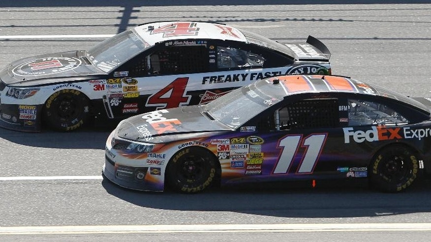 FILE - In this May 4, 2014, file photo, Denny Hamlin (11) and Kevin Harvick (4) compete during the NASCAR Aaron's 499 Sprint Cup series auto race at Talladega Superspeedway in Talladega, Ala. Harvick, who will race Hamlin, Joey Logano and fRyan Newman in the finale, has four wins this season. (AP Photo/Butch Dill, File)