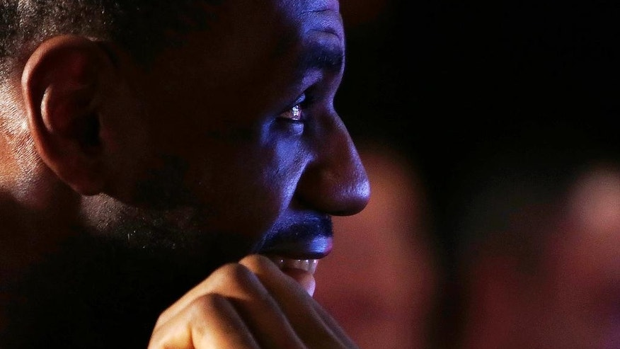 Cleveland Cavaliers' LeBron James watches a presentation during a gathering at Fenway Park in Boston, Thursday, Nov. 13, 2014. James joined a business panel to discuss the ways sponsors and athletes try to engage fans in a digital age. (AP Photo/Charles Krupa)