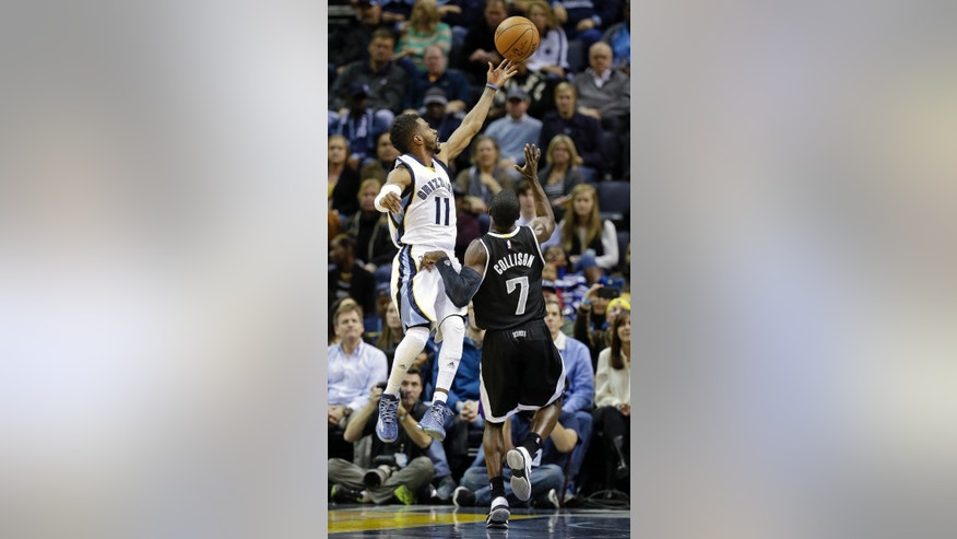 Memphis Grizzlies guard Mike Conley (11) shoots ahead of Sacramento Kings guard Darren Collison (7) in the first half of an NBA basketball game Thursday, Nov. 13, 2014, in Memphis, Tenn. (AP Photo/Mark Humphrey)