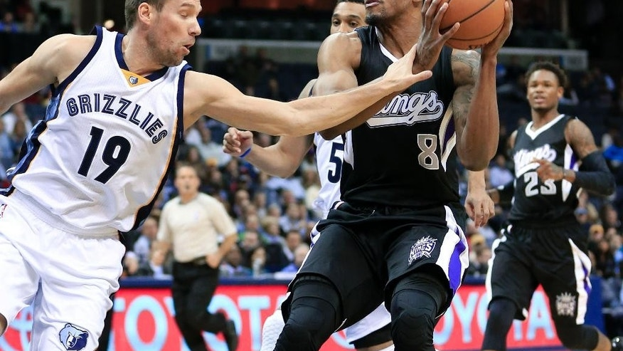 Memphis Grizzlies guard Beno Udrih (19) fouls Sacramento Kings forward Rudy Gay (8) in the first half of an NBA basketball game Thursday, Nov. 13, 2014, in Memphis, Tenn. (AP Photo/Mark Humphrey)