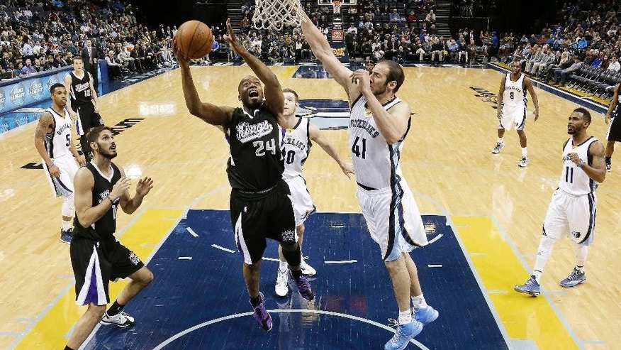 Sacramento Kings forward Carl Landry (24) shoots around the reach of Memphis Grizzlies center Kosta Koufos (41) in the first half of an NBA basketball game Thursday, Nov. 13, 2014, in Memphis, Tenn. (AP Photo/Mark Humphrey)