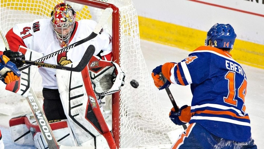 Ottawa Senators goalie Craig Anderson (41) makes the save on Edmonton Oilers' Jordan Eberle (14) during the second period of an NHL hockey game Thursday, Nov. 13, 2014, in Edmonton, Alberta. (AP Photo/The Canadian Press, Jason Franson)