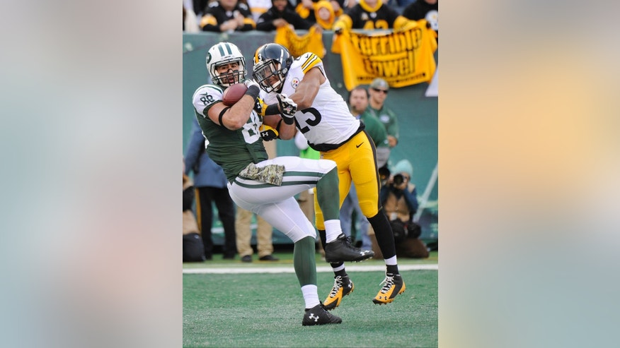 New York Jets tight end Jace Amaro (88) catches a pass for a touchdown in front of Pittsburgh Steelers' Mike Mitchell (23) during the first half of an NFL football game Sunday, Nov. 9, 2014, in East Rutherford, N.J. (AP Photo/Bill Kostroun)