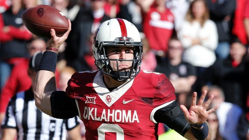Oklahoma quarterback Trevor Knight (9) passes in the third quarter of an NCAA college football game against Baylor in Norman, Okla., Saturday, Nov. 8, 2014. Baylor won 48-14. (AP Photo/Sue Ogrocki)