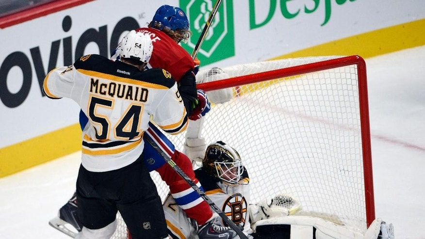 Montreal Canadiens right wing Dale Weise is checked into Boston Bruins goalie Niklas Svedberg, right, by Boston Bruins defenseman Adam McQuaid (54) during the third period of an NHL hockey game Thursday, Nov. 13, 2014, in Montreal. (AP Photo/The Canadian Press, Ryan Remiorz)