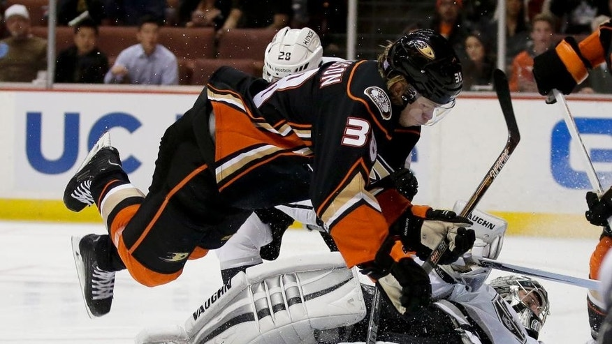 Los Angeles Kings goalie Jonathan Quick, bottom, blocks a shot by Anaheim Ducks center William Karlsson during the second period of an NHL hockey game in Anaheim, Calif., Wednesday, Nov. 12, 2014. (AP Photo/Chris Carlson)