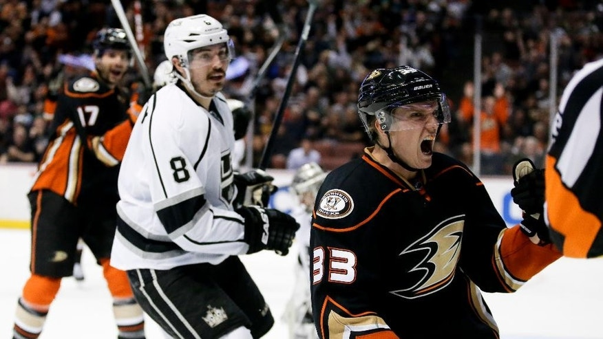 Anaheim Ducks right wing Jakob Silfverberg, right, celebrates after scoring during the second period of an NHL hockey game as Los Angeles Kings defenseman Drew Doughty watches in Anaheim, Calif., Wednesday, Nov. 12, 2014. (AP Photo/Chris Carlson)