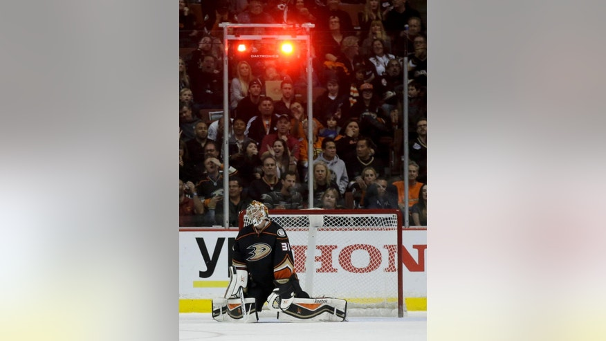 Anaheim Ducks goalie Frederik Andersen reacts after Los Angeles Kings center Trevor Lewis scored during the second period of an NHL hockey game in Anaheim, Calif., Wednesday, Nov. 12, 2014. (AP Photo/Chris Carlson)