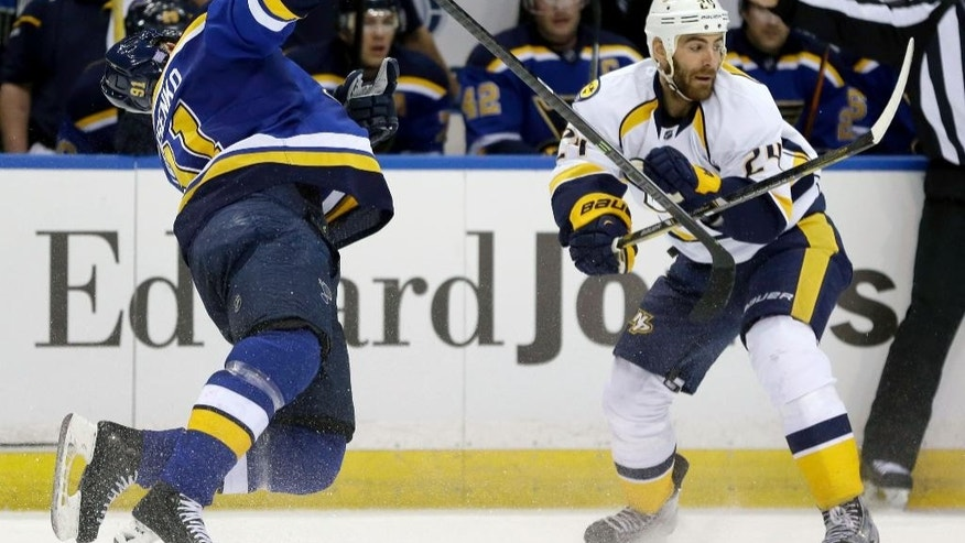 St. Louis Blues' Vladimir Tarasenko, of Russia, is sent flying after being hit by Nashville Predators' Eric Nystrom, right, during the second period of an NHL hockey game Thursday, Nov. 13, 2014, in St. Louis. (AP Photo/Jeff Roberson)