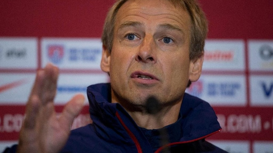 U.S. national soccer team head coach Jurgen Klinsmann speaks during a press conference at Fulham's Craven Cottage stadium in London, Thursday, Nov. 13, 2014.  The U.S. are due to play Colombia in an international friendly soccer match at the stadium on Friday.  (AP Photo/Matt Dunham)