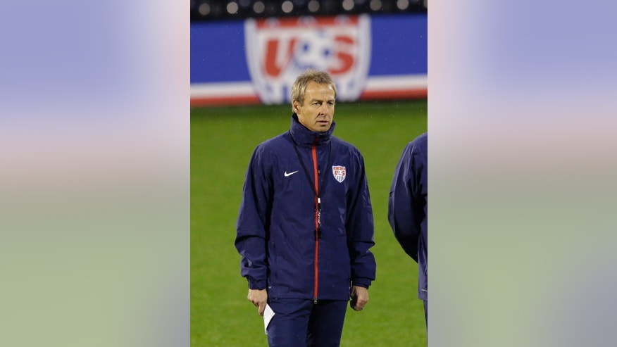 The U.S. national soccer team head coach Jurgen Klinsmann supervises a squad training session at Fulham's Craven Cottage stadium in London, Thursday, Nov. 13, 2014.  The U.S. are due to play Colombia in an international friendly soccer match at the stadium on Friday.  (AP Photo/Matt Dunham)