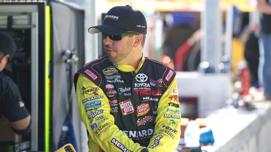 Matt Crafton waits to drive in one of the two NASCAR Nationwide Camping World Truck Series practices, Thursday, Nov. 13, 2014 in Homestead, Fla. (AP Photo/J Pat Carter)