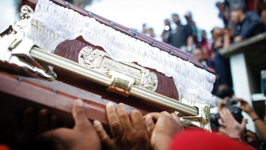 FILE - In this Oct. 28, 2014, file photo, people carry the coffin containing the remains of St. Louis Cardinals outfielder, Oscar Taveras, during his burial service, in Sosua, Dominican Republic. Taveras, who had a bright future when he signed with the Cardinals as a teenager in 2008, joins a growing list of baseball players who have died or run afoul of the law in the Dominican Republic upon returning home during major league vacation. Toxicology reports later showed that his blood-alcohol level was five times the legal limit. (AP Photo/Ricardo Arduengo,File)